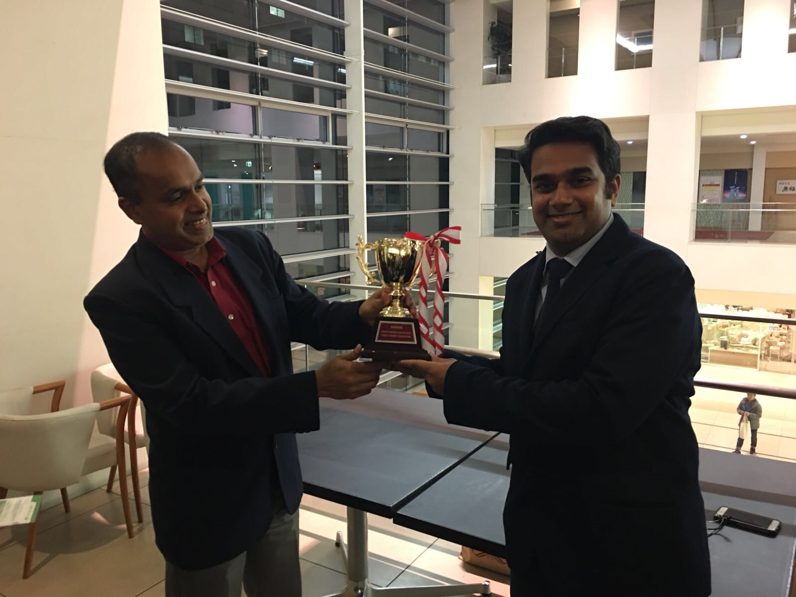Engineers skipper Vinay Mohan receives the Champions trophy