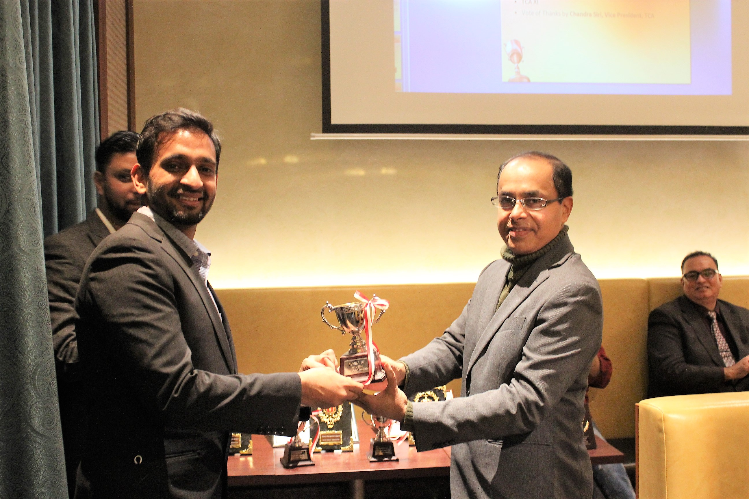Rahul receiving the JNICL trophy